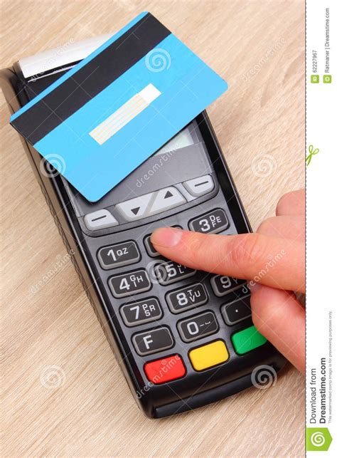 Credit card insider receives compensation from some credit card issuers as a credit card number is the string of numeric digits that identifies the credit card. Hand Of Woman Using Payment Terminal, Enter Personal Identification Number Stock Photo - Image ...