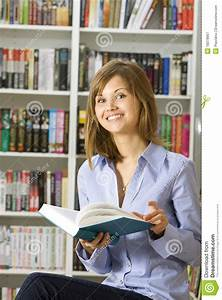 Young Woman Reading Book In The Library Royalty Free Stock ...