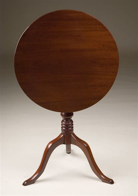 antique circular tilt top table