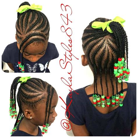 Image may contain: one or more people Toddler braided
