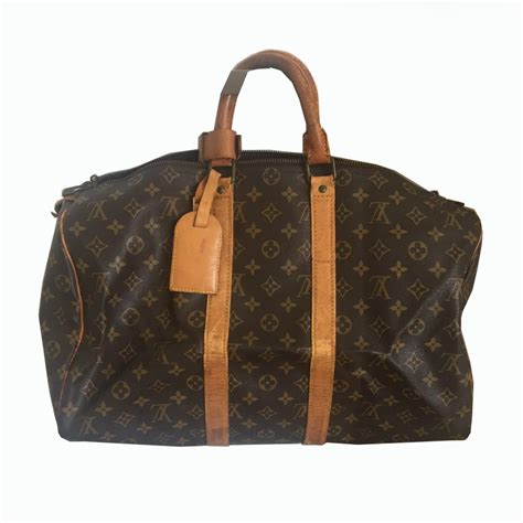 louis vuitton keepall  vintage travel bag modsie