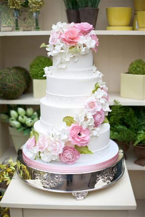 Ivory Wedding Cake With Garlands Of Pink Flowers And