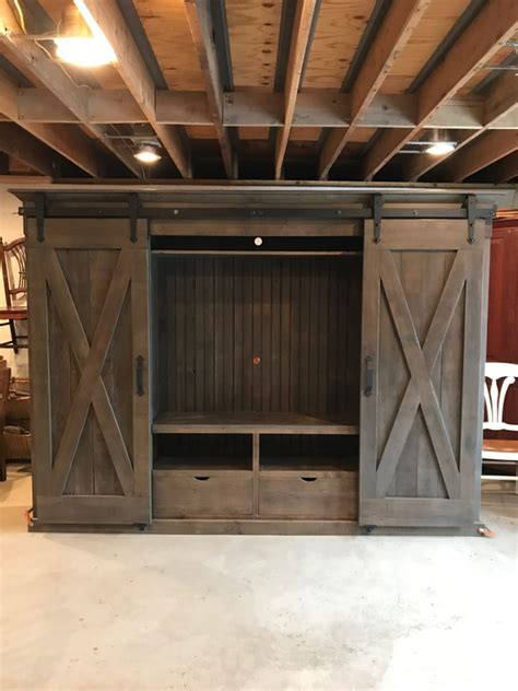 weathered gray  style barn door entertainment cabinet