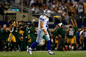 Tony Romo's career against the Packers featured ...