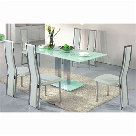 dining table in frosted glass with 4 dining chairs