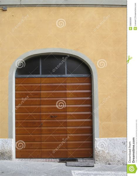 striped wooden garage door  urban street  siena italy