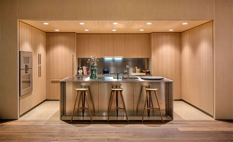 modern kitchen with oak cabinets oak cabinets and satin finish stainless steel make up this 9245