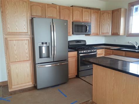 kitchen cabinets with countertops ge slate appliances whisper creek townhomes in mokena 9534