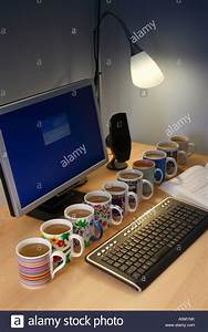 10, Mugs, Of, Coffee, Lined, Up, On, A, Desk, Stock, Photo, 10023246