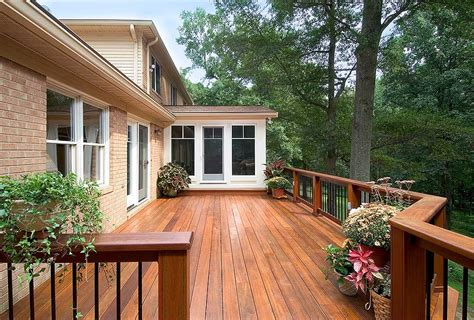 mahogany deck  sunroom commonwealth home design