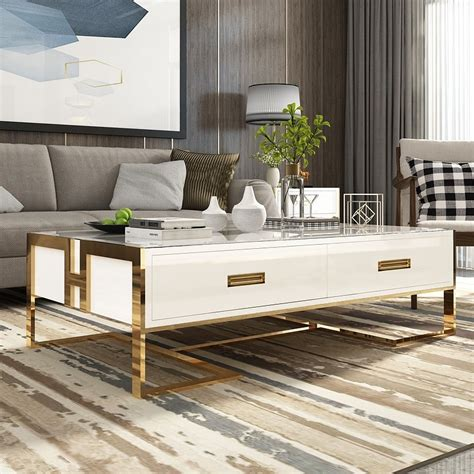 The golden hexagonal styled base with a square white top makes it alluring.we focus on providing top quality, and value to our customers with our vast selection of product categories which include decorative accessories, accent furniture, mirrors, wall. Jocise Contemporary White/Black Rectangular Storage Coffee Table with Drawers Lacquer Gold Base ...