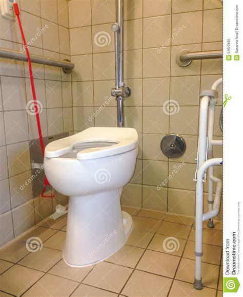 handicap restroom rails hospital toilet with call for assistance bell stock image