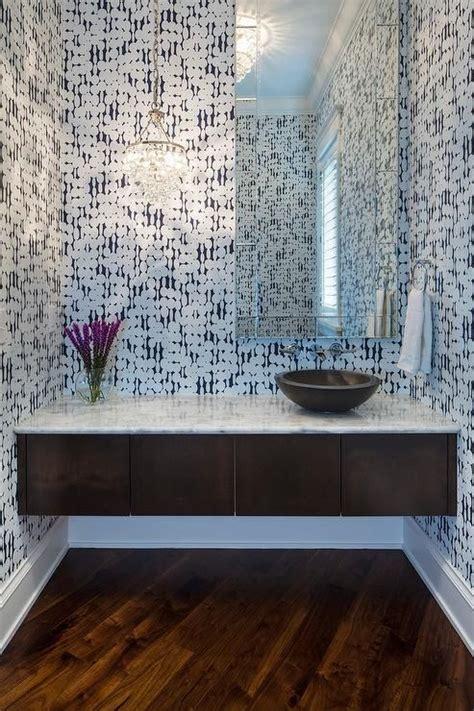 contemporary powder room features walls clad  harlequin