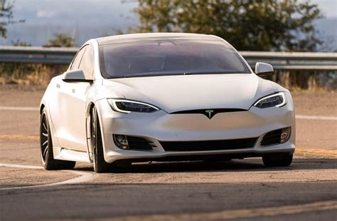 Tesla's debt rating moves closer to 'investment grade ...