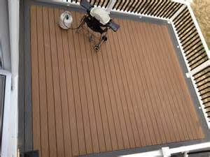 trex enhance decking in dune with a clam shell picture frame railing is beveled with