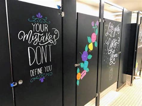parents paint motivational art   grade bathrooms