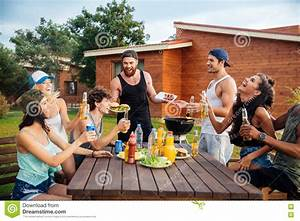 Happy Young People Laughing And Having Fun On Barbeque ...
