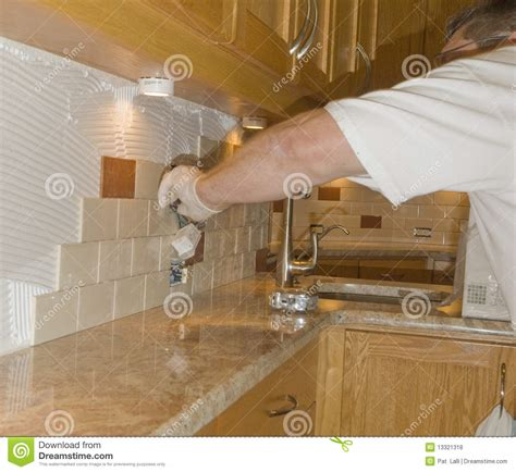 installing glass tiles for kitchen backsplashes ceramic tile installation on kitchen backsplash 12 royalty