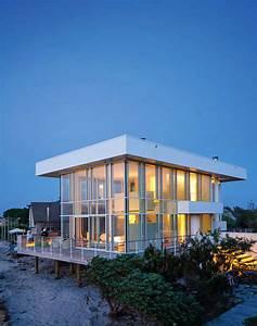 Modernized steel and glass beach house maximizes views on