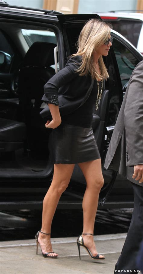 Jennifer Aniston wore a black leather skirt. | Jennifer ...