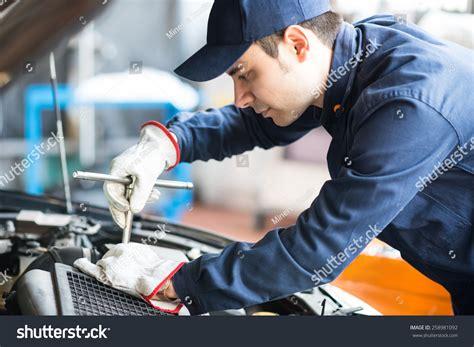 Portrait Auto Mechanic Work On Car Stock Photo 258981092