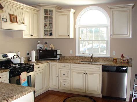 gray walls with distressed cream cabinets and pretty