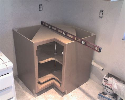 adding a lazy susan in a corner cabinet installing corner base cabinet with lazy susan