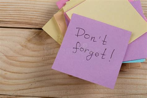 sticky notes   wooden wall stock photo image