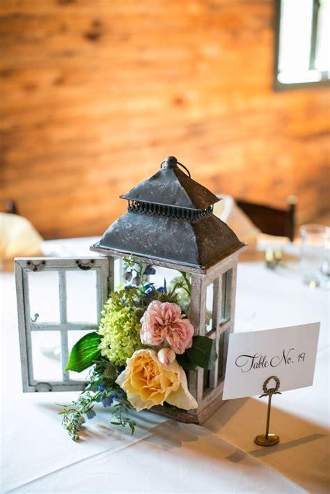 Vintage Lantern With Peach Flower Centerpiece