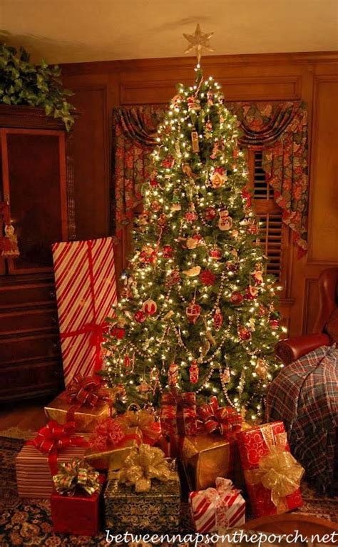 wrapping gifts with plaid ribbons and turning on christmas trees via remote control