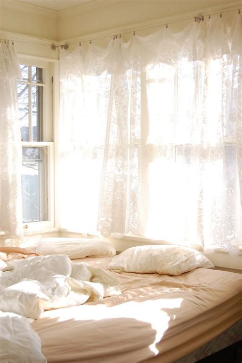 all white bedroom lets get cozy curtains