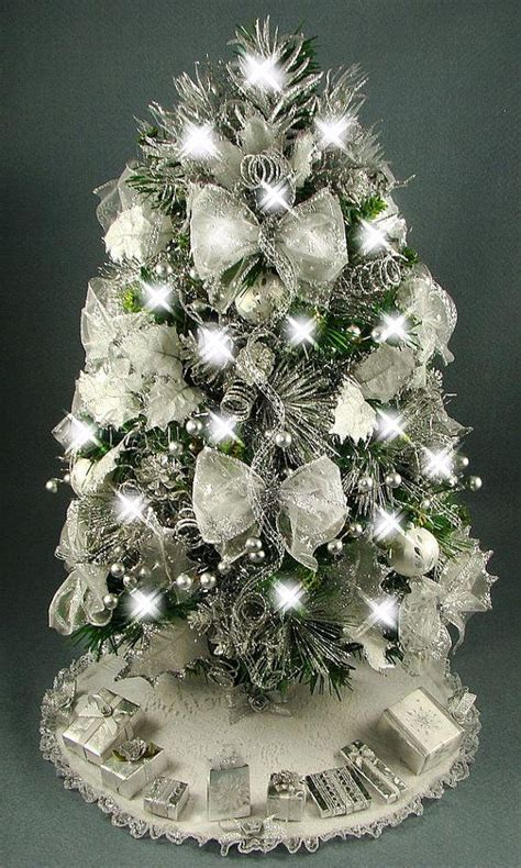decorated mini tabletop christmas tree silver and white