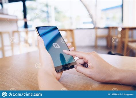 Users may exchange such digital documents as images, text. CHIANG MAI, THAILAND - JAN. 19,2019: Woman Holding HUAWEI ...