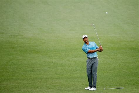 While practicing for Masters, Tiger Woods looking happy ...