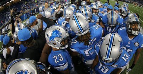 detroit lions link arms  coach  owner
