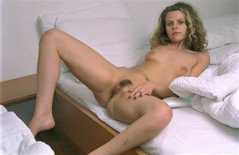 The Model Lies On Bed With Lover Top Of Her