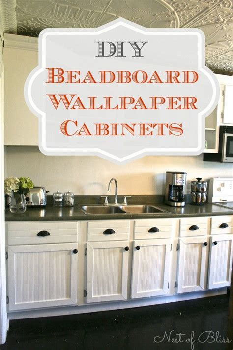 Transform Kitchen Cupboards transform cabinets with this diy beadboard wallpaper