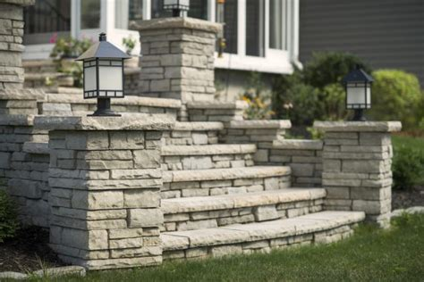 unilock pillars closeup of a patio with rivercrest wall steps and pillars