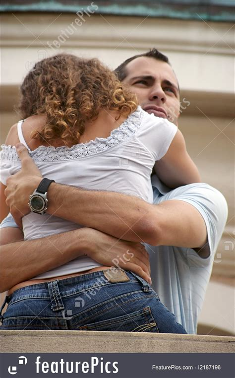 people handsome proud man hugging woman close  balcony