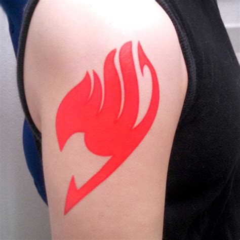Red Fairy Tail Symbol Tattoo On Shoulder