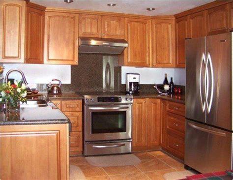 honey oak kitchen cabinets with black countertops oak