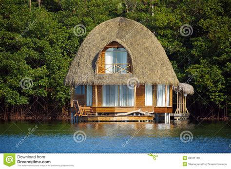 Thatched Bungalow Over Water Royalty Free Stock Images