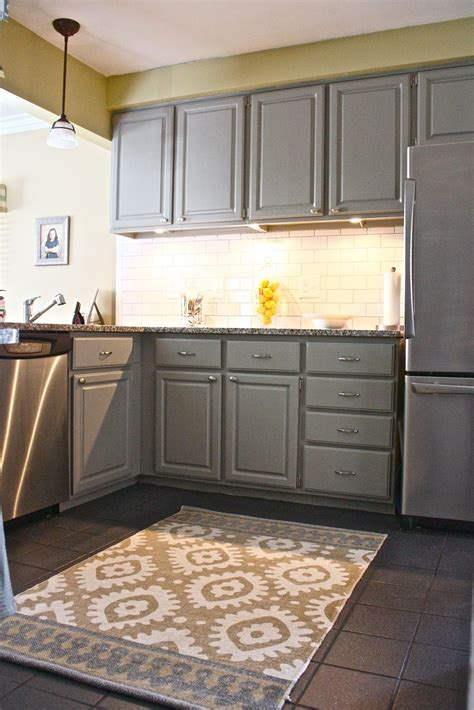 Yellow Kitchen Cupboards by Mid Gray Cabinets With Light Yellow Walls And Accents