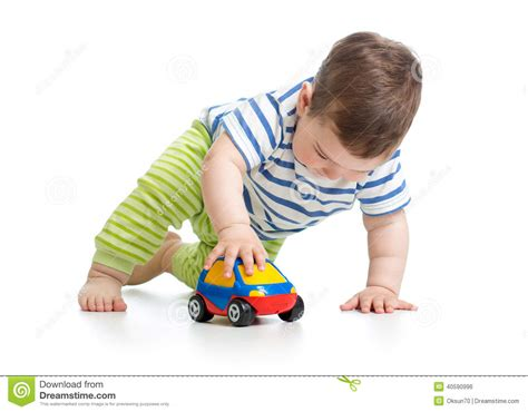 kid play car baby boy playing with toy car stock photo image