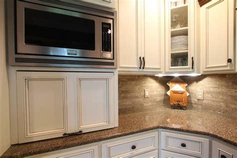 maple flat panel  applied trim schmidt custom cabinetry