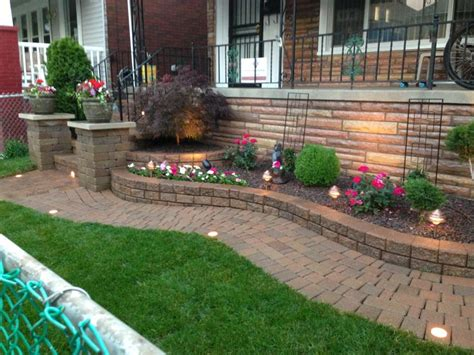 landscaping beds raised flower bed with decorative stone and a japanese maple by sandstone landscaping llc