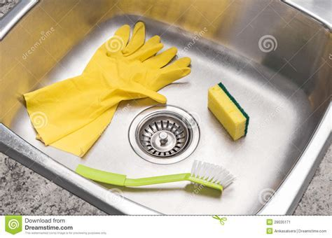 Gloves, Sponge And Brush In A Clean Kitchen Sink Stock