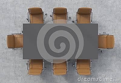 top view   conference room  dark grey rectangular table   brown leather chairs