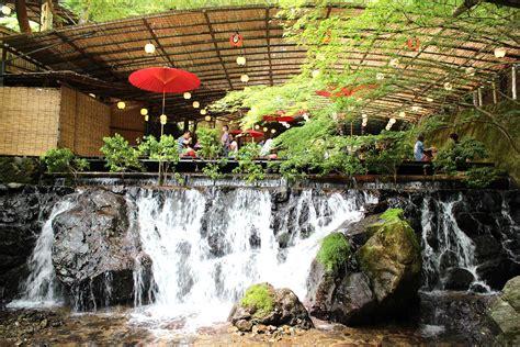 japanese paper lanterns dine atop a waterfall at these 39 kawadoko 39 restaurants