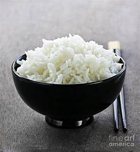 Bowl Of Rice With Chopsticks Photograph by Elena Elisseeva